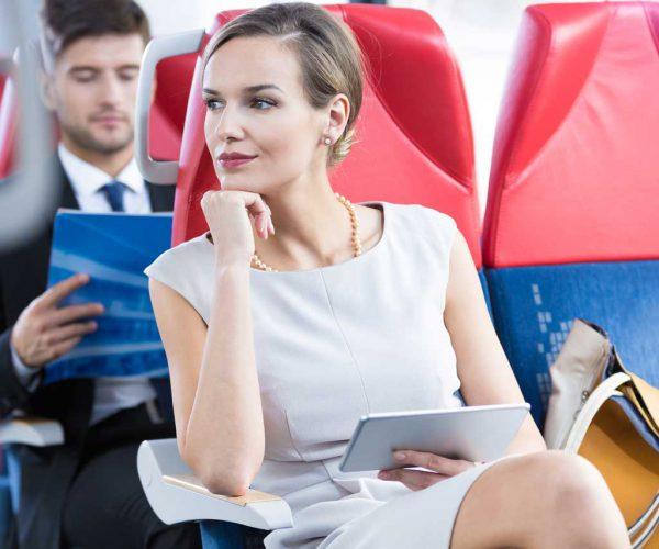 woman-airplane-sitting